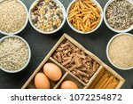 bowl with healthy whole grain... | Shutterstock . vector #1072254872
