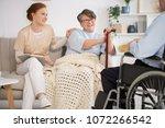 beautiful nurse spending time... | Shutterstock . vector #1072266542