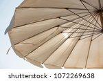 beach umbrella on sunny day   Shutterstock . vector #1072269638