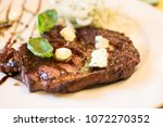 grilled beef steak with spices... | Shutterstock . vector #1072270352