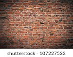 background texture of a brick wall with darker vignette - stock photo