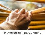hand opening slats of venetian... | Shutterstock . vector #1072278842