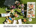 boy in blue pants lies on a... | Shutterstock . vector #1072282748