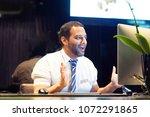 hotel manager. a men reception... | Shutterstock . vector #1072291865