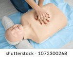 woman practicing cpr on...   Shutterstock . vector #1072300268