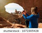 female photographer takes... | Shutterstock . vector #1072305428