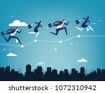 business team balancing on... | Shutterstock .eps vector #1072310942