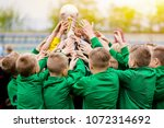 kids celebrating soccer victory.... | Shutterstock . vector #1072314692