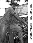 Small photo of SAN FRANCISCO CA USA APRIL 17 2015: Bronze statue of greatest Baseball Hall of Fame player, Willie Mays. In front the AT&T Giants stadium.