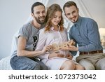 gay couple becoming parents... | Shutterstock . vector #1072373042