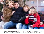 ordinary family of four... | Shutterstock . vector #1072384412