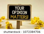 Small photo of Handwriting text Your Opinion Matters Motivational Call. Concept meaning Client Feedback Reviews are important written Wooden Notice Board the plain background Paper Balls next to it.
