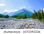 mountain river valley stones... | Shutterstock . vector #1072392236