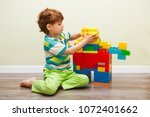 little boy playing with lots of ... | Shutterstock . vector #1072401662