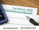 uk hmrc self assessment income... | Shutterstock . vector #1072402745