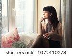 beautiful young woman sitting... | Shutterstock . vector #1072410278