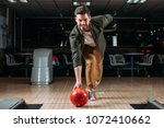 happy young man throwing... | Shutterstock . vector #1072410662