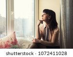 beautiful young woman sitting... | Shutterstock . vector #1072411028