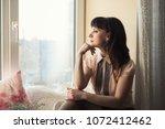 beautiful young woman sitting... | Shutterstock . vector #1072412462