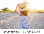young pretty  tanned woman... | Shutterstock . vector #1072413146