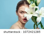 surprised woman with flowers ... | Shutterstock . vector #1072421285