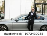 uber driver in elegant suit in... | Shutterstock . vector #1072430258