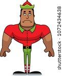 a cartoon xmas elf looking sad. | Shutterstock .eps vector #1072434638