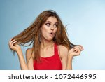 woman in red dress  red hair    ... | Shutterstock . vector #1072446995
