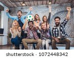 happy friends or football fans...   Shutterstock . vector #1072448342