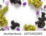 frame of black and green grapes ... | Shutterstock . vector #1072452305