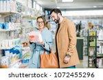 young couple choosing diapers...   Shutterstock . vector #1072455296