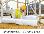 busy female architect working    Shutterstock . vector #1072471766