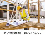 busy female architect working    Shutterstock . vector #1072471772