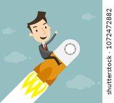 businessman on a rocket ... | Shutterstock .eps vector #1072472882