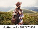 traveler hipster girl in hat...   Shutterstock . vector #1072476308