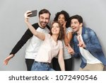 photo of happy group of friends ...   Shutterstock . vector #1072490546
