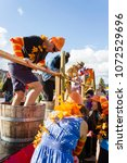 Small photo of Oliver, British Columbia, Canada - October 1, 2017: Competitors in the grape stomp at the annual Festival of the Grape located in the Okanagan Valley, Oliver, British Columbia, Canada.