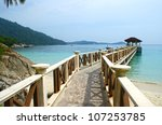 Boardwalk from a small beach on one of the two Perhentian Islands which are a small group of beautiful, coral-fringed islands off the coast of northeastern Malaysia.
