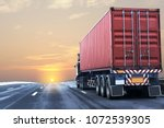 truck on highway road with red  ... | Shutterstock . vector #1072539305
