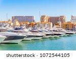 marina full of luxurious yachts ... | Shutterstock . vector #1072544105