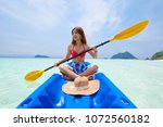 asian woman on the kayak boat... | Shutterstock . vector #1072560182