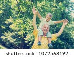 happy grandfather and child... | Shutterstock . vector #1072568192