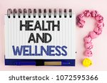handwriting text health and... | Shutterstock . vector #1072595366
