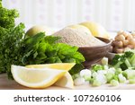 Ingredients for meal including lemon, cucumber, amaranth grains, chickpeas and fresh mint. - stock photo