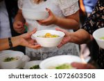 feeding the poor to hands of a... | Shutterstock . vector #1072603508