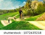 mountain biker jumping on bike...   Shutterstock . vector #1072635218