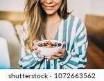 crop woman close up eating oat... | Shutterstock . vector #1072663562