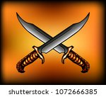 two crossed knives with an... | Shutterstock .eps vector #1072666385