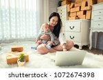 beautiful young asian mother... | Shutterstock . vector #1072674398