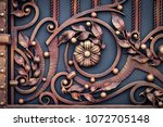 wrought iron gates  ornamental... | Shutterstock . vector #1072705148